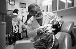 Shatila, UNRWA camp. &quot;Beit Atfal As Sumood&quot; a social aid NGO. Dr. Ahmad Abou Rayya, the NGO's dentist is taking care of Tarek, one of the children.<br />  <br /> Chatila, camp de l'UNRWA. &laquo;Beit Atfal As Soumoud&raquo;, une ONG d'aide sociale. Le Dr. Ahmad Abou Rayya, dentiste au centre, soigne un &eacute;l&egrave;ve du centre, Tarek.