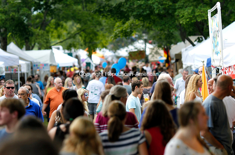 New Milford, CT-27 July 2012-072712CM05-  Throngs of people take to the green during the 45th annual Village Fair Days Friday night in New Milford.  The event, which is sponsored by the Greater New Milford Chamber of Commerce is the largest annual event in New Milford.  The event continues today (Saturday) and will showcase live entertainment,  food, hundreds of vendor and community booths, and various activities.   Christopher Massa Republican-American