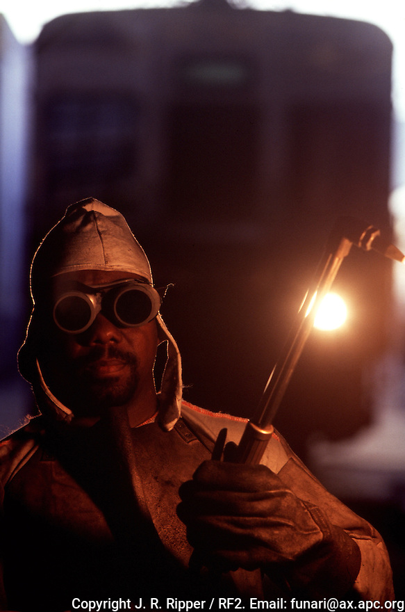 Portrait of black worker, welding. railway employee.