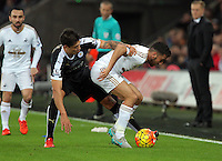 Shinji Okazaki of Leicester City challenges Neil Taylor of Swansea during the Barclays Premier League match between Swansea City and Leicester City at the Liberty Stadium, Swansea on December 05 2015