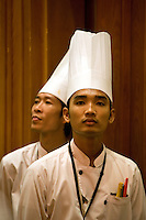 December 31st, 2008_Phnom Penh, Cambodia_ Kitchen staff from the Nagaworld Hotel and Casino in Phnom Penh, watch a grand New Year's event taking place there.   Photographer: Daniel J. Groshong/Tayo Photo Group