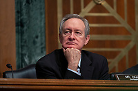 United States Senator Mike Crapo (Republican of Idaho) listens as Chair of the Federal Reserve Jerome Powell testifies before the U.S. Senate Committee on Banking, Housing, and Urban Affairs at the United States Capitol in Washington D.C., U.S. on Wednesday, February 12, 2020.  <br /> <br /> Credit: Stefani Reynolds / CNP/AdMedia