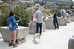 Sculptors working on local Portland stone in a community open air studio space at Tout Quarry, Isle of Portland, Dorset, England