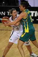 Ferns forward Lisa Wallbutton is pressured by Hollie Grima during the International women's basketball match between NZ Tall Ferns and Australian Opals at Te Rauparaha Stadium, Porirua, Wellington, New Zealand on Monday 31 August 2009. Photo: Dave Lintott / lintottphoto.co.nz
