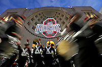 Ohio State University cheerleaders march into Ohio Stadium before the game against Penn State on October 17, 2015. (Chris Russell/Dispatch Photo)