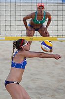 April Ross, of the United States, foreground, in action against Brazil's Taiana de Souza Lima during the women's final match between Brazil and United States at the Beach Volleyball World Tour Grand Slam, Foro Italico, Rome, 23 June 2013. Brazil defeated United States 2-1.<br /> UPDATE IMAGES PRESS/Isabella Bonotto