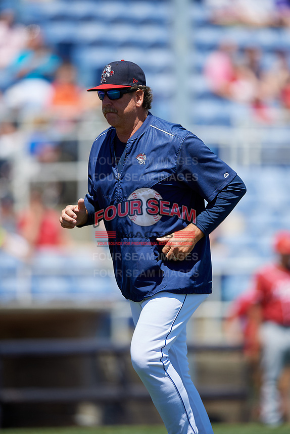 Binghamton Rumble Ponies pitching coach Frank Viola (48) jogs back to the dugout after a mound visit during a game against the Altoona Curve on June 14, 2018 at NYSEG Stadium in Binghamton, New York.  Altoona defeated Binghamton 9-2.  (Mike Janes/Four Seam Images)