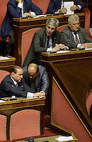 Roma, 2 Ottobre 2013<br /> Senato <br /> Silvio Berlusconi parla con Scilipoti sugli scranni del PDL durante l'intervento del Primo  Ministro Enrico Letta