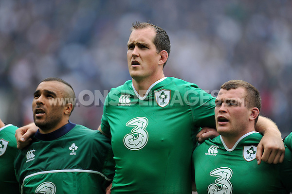 Simon Zebo, Devin Toner and Jack McGrath of Ireland sing during the anthems. QBE International match between England and Ireland on September 5, 2015 at Twickenham Stadium in London, England. Photo by: Patrick Khachfe / Onside Images
