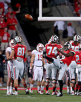 Ohio State Buckeyes quarterback Braxton Miller (5) punts the ball as time expires against Wisconsin at Ohio Stadium on Saturday, September 28, 2013. (Columbus Dispatch photo by Jonathan Quilter)