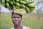 A woman carries bananas to market in Nyei, a village in SOuthern Sudan where people have returned after years in exile to rebuild their land after a devastating civil war. NOTE: In July 2011, Southern Sudan became the independent country of South Sudan