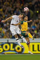 MELBOURNE, AUSTRALIA - MAY 24, 2010: Tim Cahill of the Qantas Socceroos and Ryan Nelsen of New Zealand fight for the ball at the FIFA World Cup farewell match between Australia and New Zealand at the Melbourne Cricket Ground, 24 May, 2010 in Melbourne, Australia. Photo by Sydney Low / www.syd-low.com