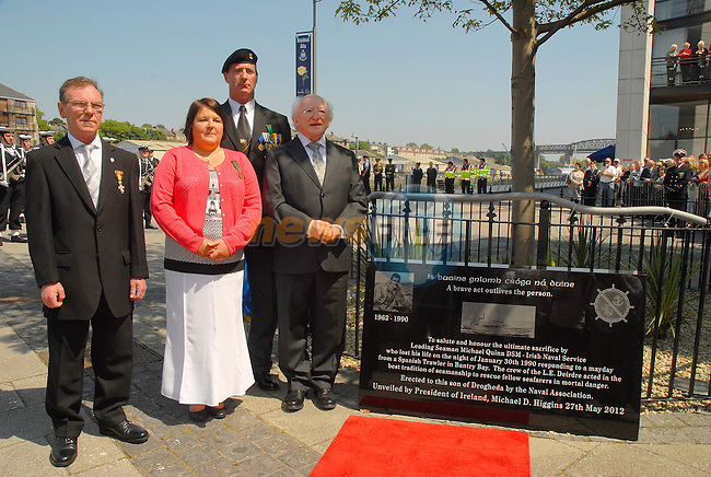 President Michael D. Higgins pictured with Leading Seaman  Michael Quinn's sister Angela Dunne and her husband Joachim after he had unveiled a plaque to the memory of the Seaman who died at sea in 1990 whilst trying to rescue the crew of a fishing vessel off the coast of County Cork.
