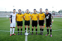 DC United midfielder Santino Quaranta (25)  and New England Revolution Chris Tierney (8) with referees at the coin toss.   The New England Revolution defeated DC United 3-2 in US Open Cup match , at the Maryland SoccerPlex, Tuesday  April 26, 2011.