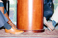 """Moderators shoes are visible under the table as New Jersey governor and Republican presidential candidate Chris Christie speaks at a """"Life of the Party"""" event at the New Hampshire Institute of Politics at Saint Anselm College in Goffstown, New Hampshire, on Tues., Feb. 2, 2016. The event is put on by Stay Work Play NH, a group for young professionals in the state. The day before, Christie tenth in the Iowa Caucus."""