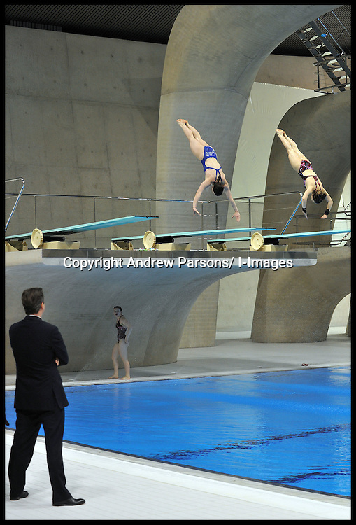 Britain's Prime Minister David Cameron watches members of the British Diving team during a visit to the Olympic Aquatic Centre on January 9, 2012 in London, England. Cameron held a cabinet meeting at the 2012 Olympic Games site and highlighted the 'lasting legacy' the London 2012 Olympics will leave, as the London Olympics countdown enters its final 200 days, Monday January 9, 2012. Photo By Andrew Parsons/ i-Images