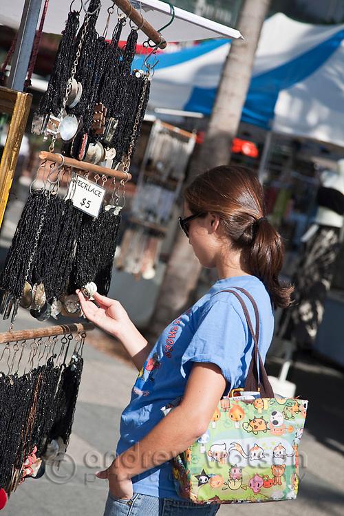 Tourist shopping at the weekend Esplanade Markets.  Cairns, Queensland, Australia
