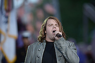 Washington, DC - May 24, 2014: American Idol season 13 winner Caleb Johnson performs the Star Spangled Banner during a dress rehearsal for the National Memorial Day Concert May 24, 2014. (Photo by Don Baxter/Media Images International)