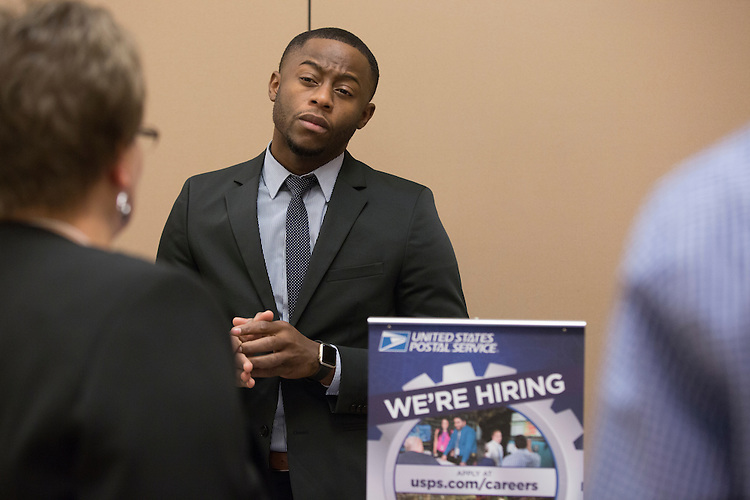 Renault Turner, a representative with the United States Postal Service, talks about job opportunites with USPS at the Institute of Industrial and Systems Engineering Regional Conference in Baker Center on Feb. 25, 2017.