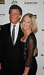 HOLLYWOOD, CA - January 22: Olivia Newton-John and husband John Easterling arrive at the G'Day USA Australia Week 2011 Black Tie Gala at the Hollywood Palladium on January 22, 2011 in Hollywood, California.