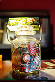 USA, California, San Francisco, peace buttons in a jar at the Red Victorian bed and breakfast, the Haight district