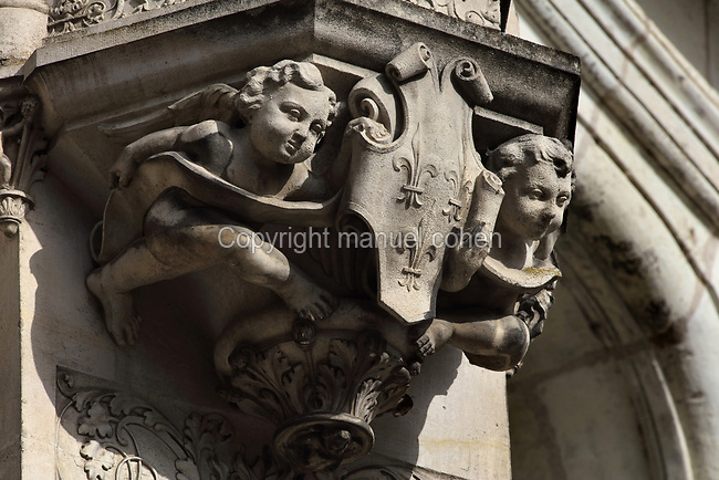 Cherubs holding a coat of arms with 3 fleur de lys, cul-de-lampe corbel sculpture from the monumental spiral staircase, 16th century, French School, on the interior South East facade of the Francois I wing, in Renaissance style, at the Chateau Royal de Blois, built 13th - 17th century in Blois in the Loire Valley, Loir-et-Cher, Centre, France. The staircase is covered in bas-relief sculptures and looks onto the courtyard of the chateau. The chateau has 564 rooms and 75 staircases and is listed as a historic monument and UNESCO World Heritage Site. Picture by Manuel Cohen