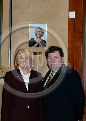 BRUSSELS - BELGIUM - 23 FEBRUARY 2004--Inauguration of the Anna LINDH EU-Council meeting room.--Laila FREIVALDS, The Swedish Minister of Foreign Affairs, and Brian COWEN (L), The Irish Minister of Foreign Affairs, standing next to a photograph of Anna LINDH, Swedens former Minister of Foreign Affairs. -- PHOTO: ERIK LUNTANG / EUP-IMAGES
