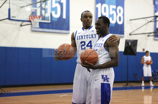 E. J. Floreal, left, goofing off with Dominique Hawkins, right, during basketball photo media day in Lexington, Ky., on Thursday, September 12, 2013. Photo by Eleanor Hasken l Staff