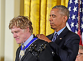 United States President Barack Obama presents the Presidential Medal of Freedom to actor, director, producer, businessman, and environmentalist Robert Redford during a ceremony in the East Room of the White House in Washington, DC on Tuesday, November 22, 2016.  The Presidential Medal of Freedom is the Nation's highest civilian honor.<br /> Credit: Ron Sachs / CNP