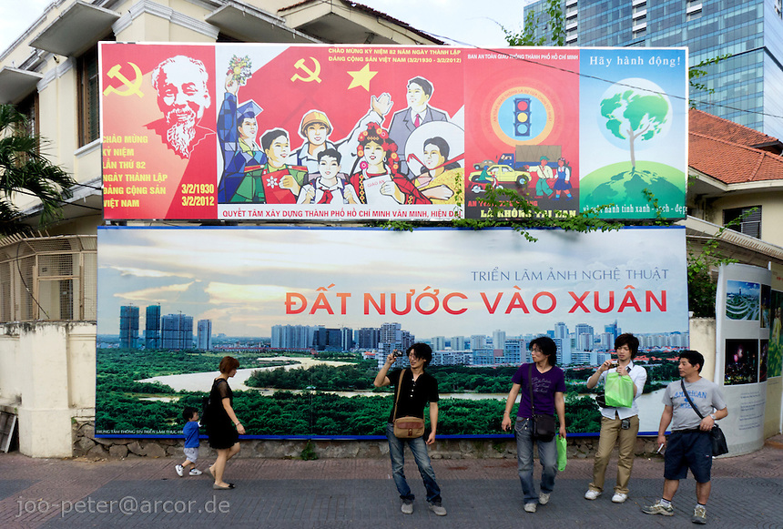 communist propaganda billboard with traditional symbols (Lenin, Ho Chi Minh, workers) and modern city developement  vision  in Ho Chi Minh City / Saigon,  Vietnam