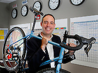 NWA Democrat-Gazette/DAVID GOTTSCHALK - Jeff Clapper, chairman and chief executive officer of 8th & Walton, with his bicycle that he commutes to work on in his office in Bentonville Wednesday, June 24, 2015.