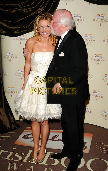 GERI HALLIWELL  & RICHARD ATTENBOROUGH.Attending the Galaxy British Book Awards held at the Grosvenor Hotel, Park Lane, London, England,.April 9th 2008..full length kiss kissing cheek white strapless prom dress silver shoes black suit arm around shoulder .CAP/CAN.©Can Nguyen/Capital Pictures