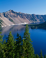 USA, Oregon, Crater Lake National Park, West rim of Crater Lake with Hillman Peak (center) overlooking Wizard Island.