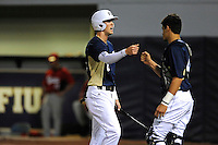 2 March 2012:  FIU outfielder Nathan Burns (6) high-fives with a teammate after scoring a run early in the game as the FIU Golden Panthers defeated the Brown University Bears, 6-5, at University Park Stadium in Miami, Florida.