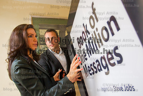 Hungarian model and celebrity Sylvi Bodi (L) poses with the Book of One Million Messages during its official presentation in Budapest, Hungary on February 24, 2012. ATTILA VOLGYI