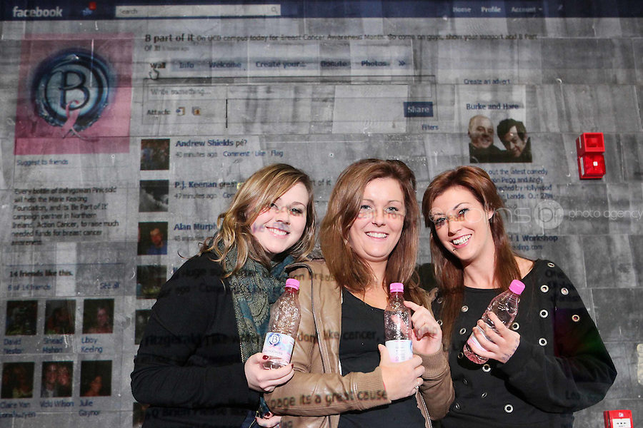 NO Repro Fee. 27/10/2010.  Ballygowan Pink's B Part Of It campaign in support of Breast Cancer Awareness Month. Hundreds of UCD students got behind Ballygowan Pink's B Part Of It campaign in support of Breast Cancer Awareness Month. Pictured are  Deirdre Flynn, Lisa Smith and Ash Riely from Dublin who posted messages of support to the life-sized Facebook Wall which was projected onto the entrance of UCD library. A live stream of students' messages was seen throughout the day to raise awareness of breast cancer and support the Marie Keating Foundation. Picture James Horan/Collins Photos