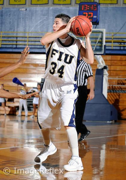 Florida International University men's basketball guard Michael Dominguez (34) plays against the University of Toledo.  FIU won the game 50-46 on November 24, 2008 at Miami, Florida. .
