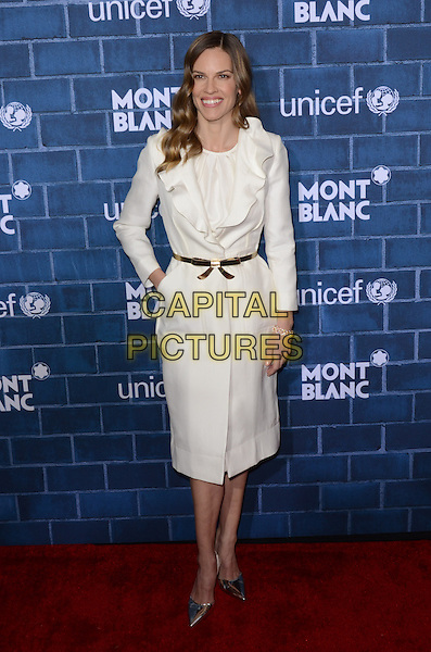 Hilary Swank.Montblanc Hosts Pre-Oscar Charity Brunch Benefiting UNICEF held at Hotel Bel-Air, Los Angeles, California, USA..February 23rd, 2013.full length dress white ruffle collar jacket coat silver pointy shoes belt gold hand in pocket .CAP/ADM/TW.©Tonya Wise/AdMedia/Capital Pictures