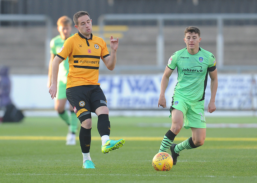 Newport County's Matthew Dolan under pressure from Colchester United's Diaz Wright<br /> <br /> Photographer Kevin Barnes/CameraSport<br /> <br /> The EFL Sky Bet League Two - Newport County v Colchester United - Saturday 17th November 2018 - Rodney Parade - Newport<br /> <br /> World Copyright © 2018 CameraSport. All rights reserved. 43 Linden Ave. Countesthorpe. Leicester. England. LE8 5PG - Tel: +44 (0) 116 277 4147 - admin@camerasport.com - www.camerasport.com