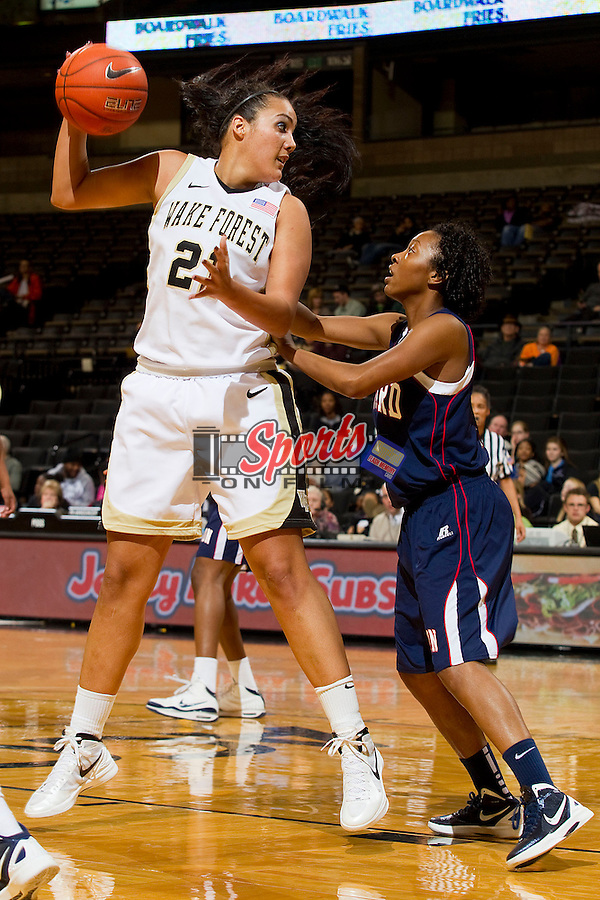 Sandra Garcia #21 of the Wake Forest Demon Deacons catches the ball in the low post as Tamoria Holmes defends during second half action at the LJVM Coliseum on December 18, 2011 in Winston-Salem, North Carolina.  The Bison defeated the Demon Deacons 63-59 in overtime.    (Brian Westerholt / Sports On Film)