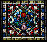 Ornamental stained glass window with flowers and floral decoration, All Saints church, Stanton St Bernard, Wiltshire circa 1867