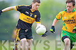 Kieran O'Leary of Dr Crokes in action against Gneeveguilla's Danny O'Connor in Gneeveguilla last Sunday evening in round 1 of the Garvey's Supervalue County Senior Championship.