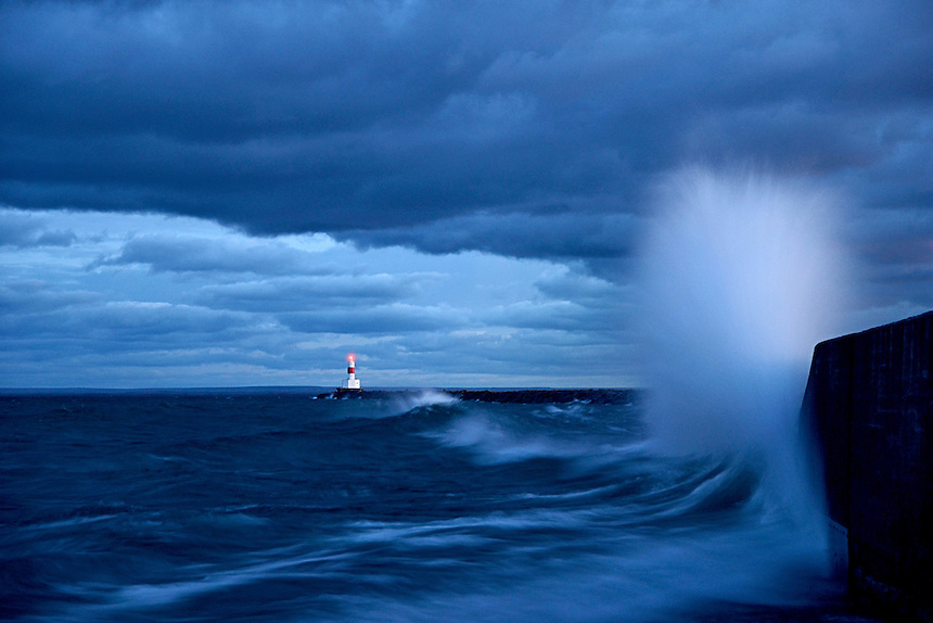 Large waves crashing into the Upper Harbor Breakwater in Marquette, Michigan.