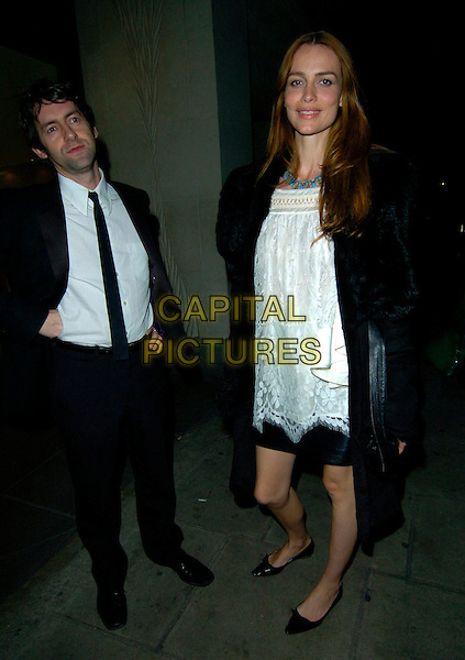 SAFFRON BURROWS & GUEST.The Harper's Bazaar & Moet Gold party, Almada bar & nightclub, London, England..November 1st, 2007.full length black coat jacket suit white dress tall short .CAP/CAN.©Can Nguyen/Capital Pictures