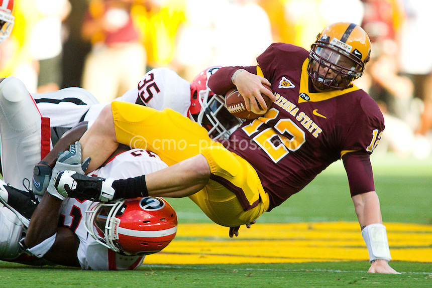 Sept 20, 2008; Tempe, AZ, USA; Arizona State Sun Devils quarterback Rudy Carpenter (12) gets sacked by two Georgia Bulldogs defenders in the first quarter of a game at Sun Devil Stadium.