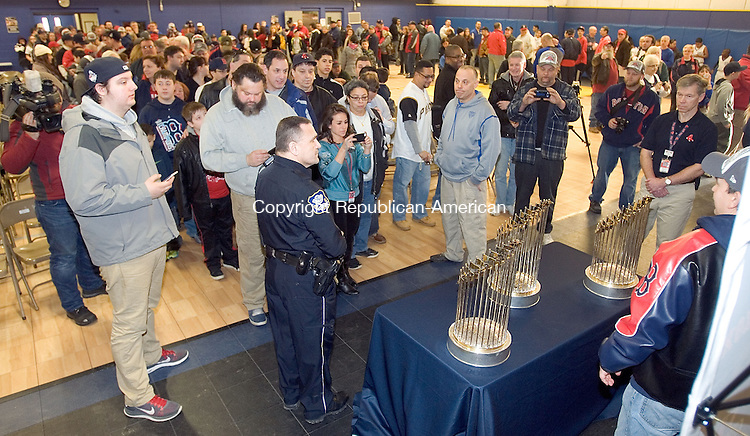 WATERBURY CT. 08 February 2014-020914SV10-A large crowd lines up for a chance to have their picture taken with the Red Sox championship trophies in Waterbury Sunday. The Boston Red Sox World Series trophy for the team's 2004, 2007 and 2013 championship made a stop at the Police Activity League building on Division Street.<br /> Steven Valenti Republican-American
