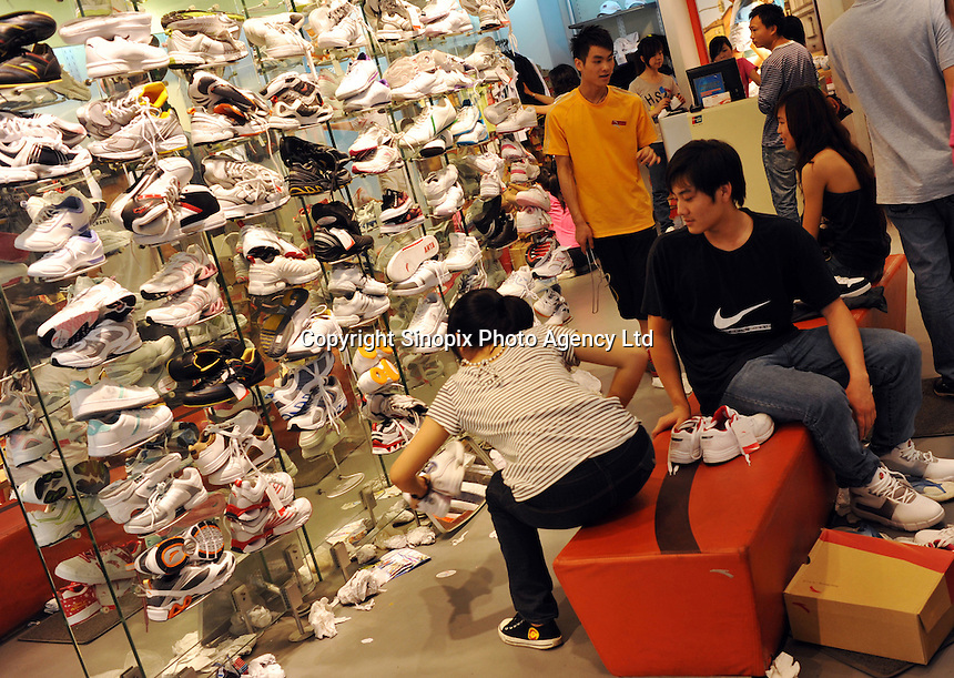 Consumers at a sports shoes shop in Foshan, Guangdong Province, China. Despite the general economic down-turn China's domestic demand is helping China to maintain positive economic growth..24 Apr 2009