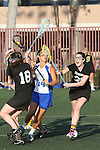 Santa Barbara, CA 02/18/12 - Sophie Didonato (Washington #18), Kristen Moore (Washington #35) in action during the UCSB-Washington matchup at the 2012 Santa Barbara Shootout.  UCSB defeated Washington