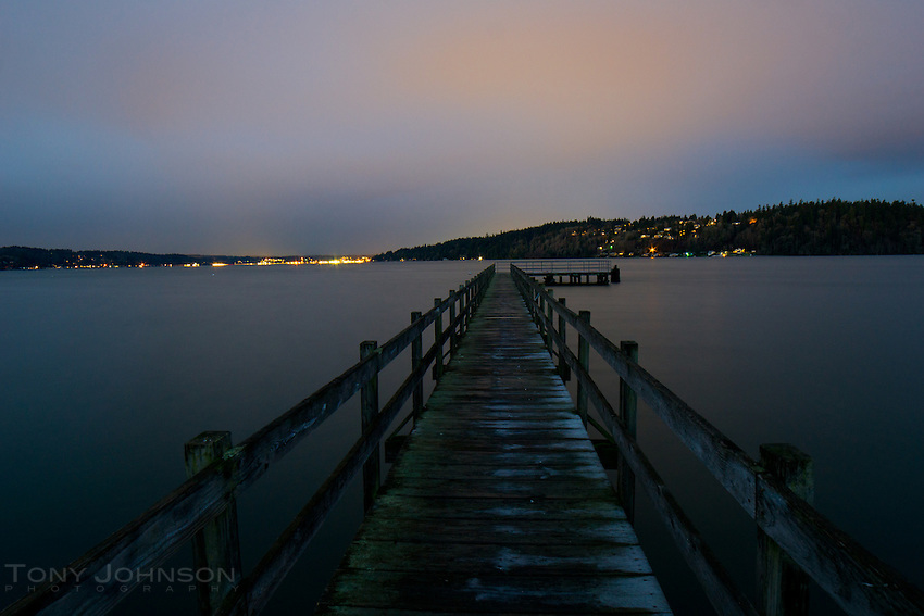 night sky lit by the lights of Bremerton over the Point White Dock on Bainbridge Island.