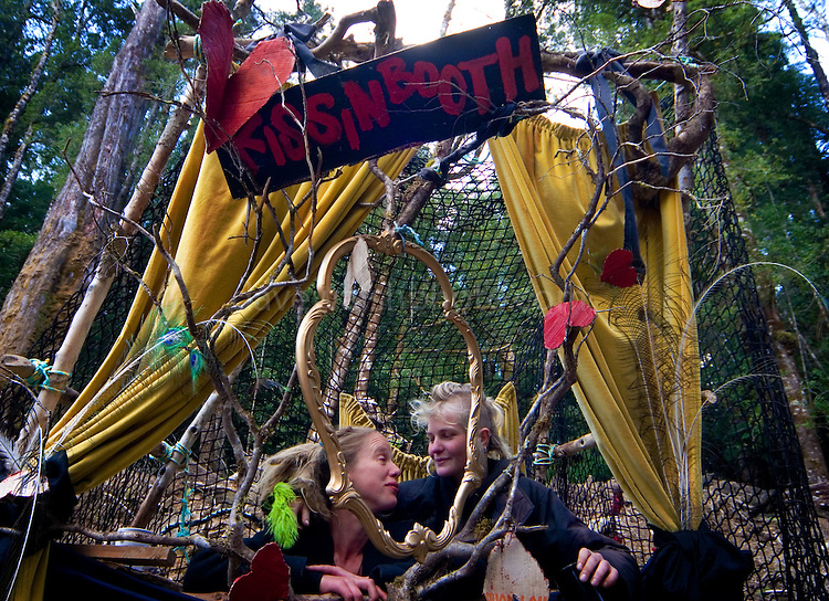 Two forest activists running the kissing booth - a novel method of fundraising, at the at the Upper Florentine party, Tasmania.  Protestors have blocked the forest access road made by contractors for Forestry Tasmania, in order to stop the logging of old growth forest in what is potentially a World Heritage Area.